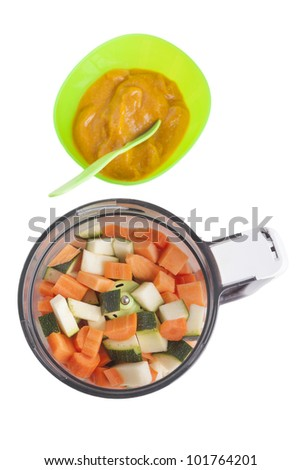studio shot of puree homemade baby food  with steamed zucchini ,sweet potatoes and carrots, isolated on a white background.