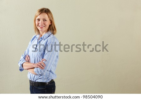 Studio Shot Of Relaxed Middle Aged Woman