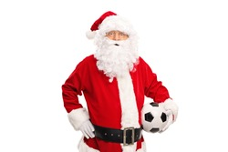 Studio shot of Santa Claus holding a soccer ball and looking at the camera isolated on white background