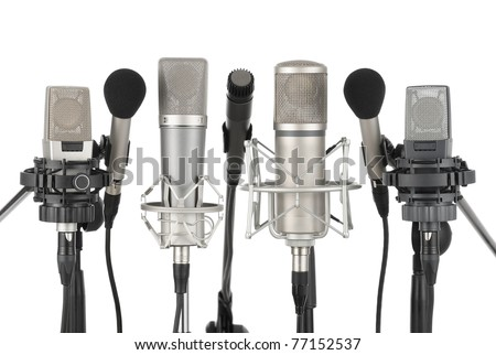 Studio shot of seven professional microphones in a row on white background