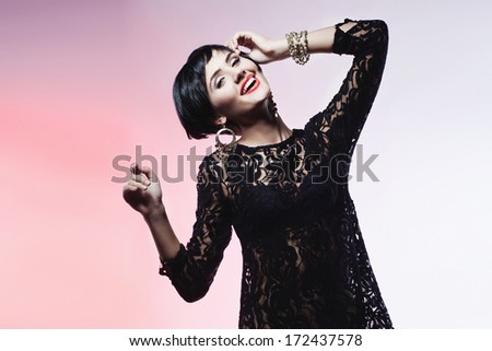 Studio shot of Sexy Fashion Woman in Black Dress. Professional Makeup and Hairstyle #172437578