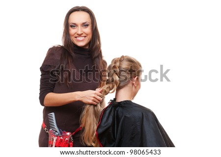 studio shot of smiley hairdresser doing a plait. white background
