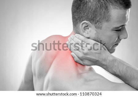 Studio shot of sportsman with pain in neck