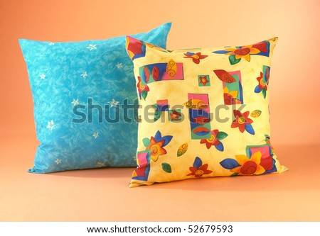 Studio shot of two pillows / cushions isolated on clean background.