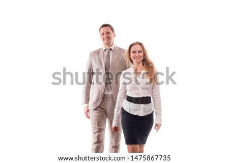 Studio shot of two smiling young employees or a businessman, a man and a woman, confidently purposefully walk. Teamwork concept, young entrepreneurs, confident youth