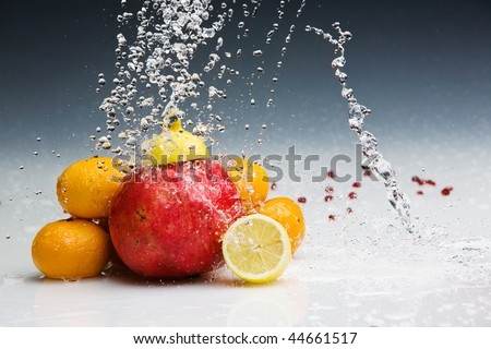Studio shot of various fruits with water splashes frozen by Broncolor Grafit A4