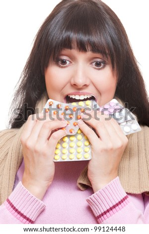 studio shot of woman eating pills. over white background - stock photo
