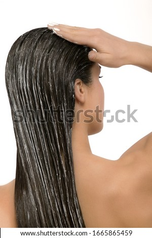 Studio shot of woman with conditioner in hair