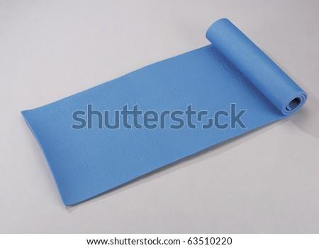 Studio shot of yoga mat isolated on plain background.