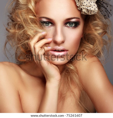 studio shot of young beautiful woman with makeup