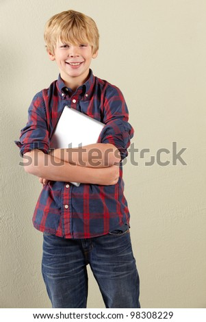 Studio Shot Of Young Boy Holding Tablet Computer - stock photo