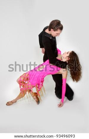 studio shot of young couple dancing