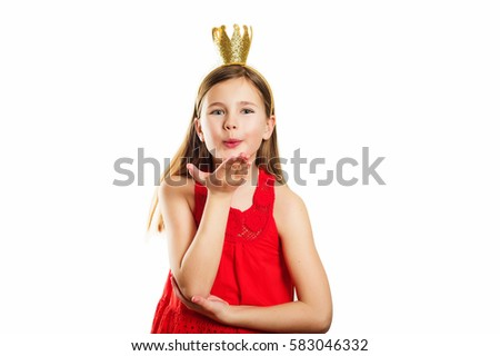 Studio shot of young little 9-10 year old girl, wearing red dress and gold crown headband, isolated on white background,  sending a kiss