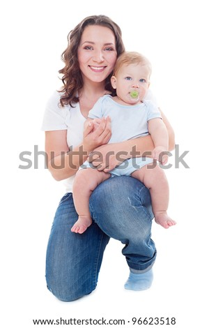 studio shot of young smiley mother with her son