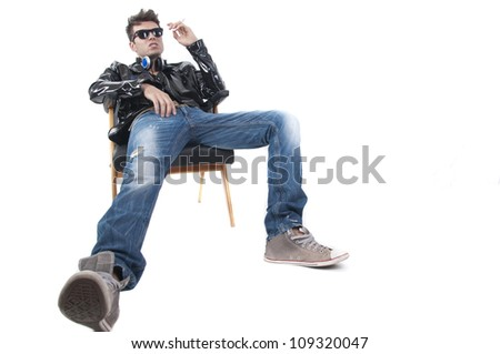 Studio shot on white background , male model smoking cigarette