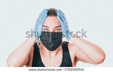 Photo of studio shot on white background of a sick young woman wearing mask and latex gloves, stressed by quarantine.
