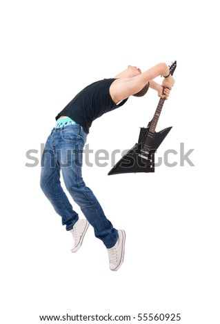 studio shot picture on isolated background of a angry man holding a guitar and trying to break it