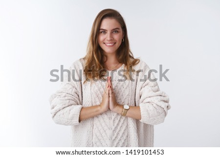 Studio shot pleasant friendly-looking calm relaxed happy young millenial european woman press palms together namaste gesture welcoming buddhist gesture smiling positive, greeting yoga master #1419101453