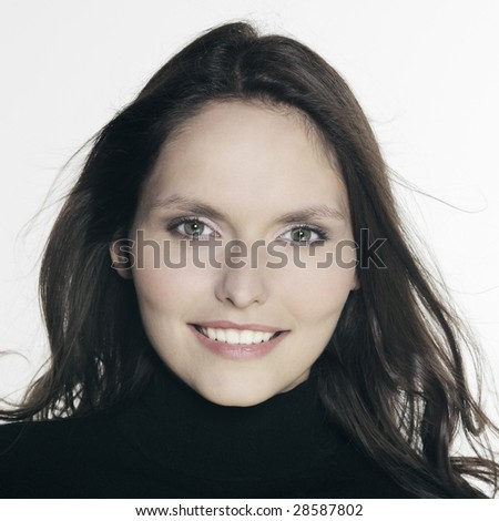 studio shot portrait of a beautiful 25 years old smiling woman