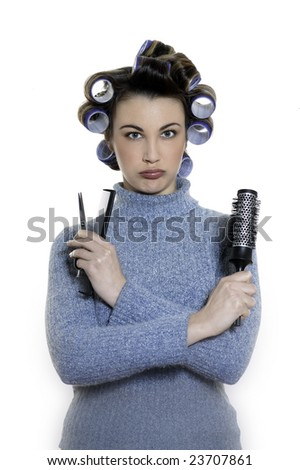 studio shot portraits of a young funny and cute and annoyed woman on a white background being a hair-curlers victim
