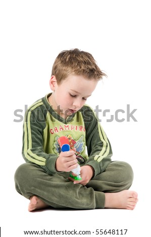 Studiopicture of a child who is going to brush his teeth, isolated on white.