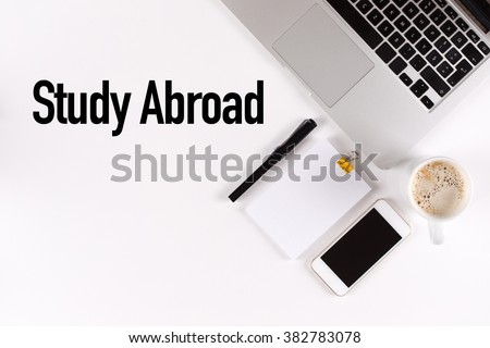Study Abroad text on the desk with copy space #382783078