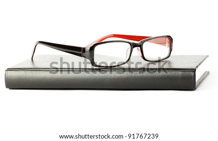 Study. Book with eyeglass on the white background