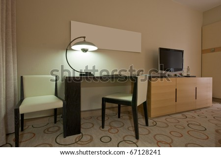 Study room with writing desk armchair and lcd tv set