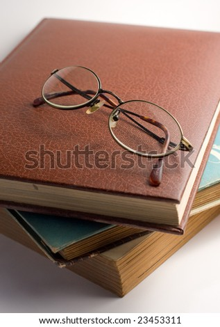 b87193ec0197 Study scene old books and glasses white background antique vintage old  older elder reading studying read
