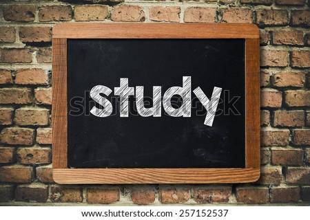 Study word on Blackboard.  Study word on Blackboard on bricks wall