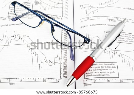 studying economy with trader book - stock photo