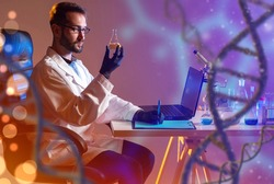 Studying genetic mutation. Male laboratory assistant near DNA helix. Work genetic mutation. Geneticist with test tube writes down results of research. Human genome chains near scientist. DNA testing