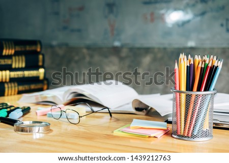 studying workbook and colorful pencil in class. Foto stock ©