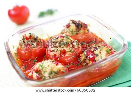 Stuffed and baked tomatoes with rice and mushrooms