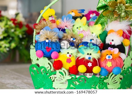 Stuffed animal toys in a basket.