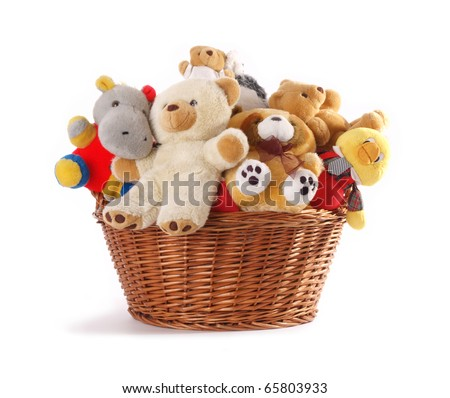 Stuffed animal toys in a basket isolated on a white background