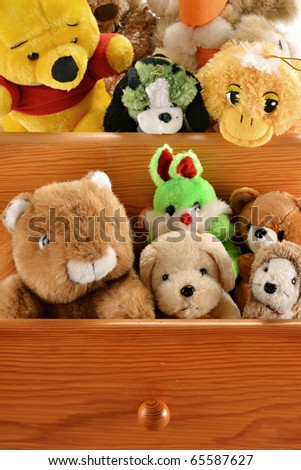 Stuffed animal toys in drawers - stock photo