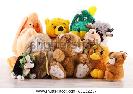 Stuffed animal toys on the wooden floor isolated on white