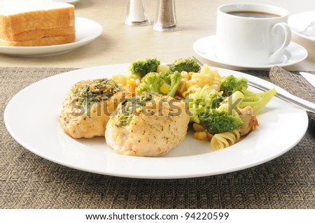 Stuffed chicken breasts with pasta salad and sliced bread