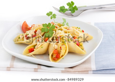 stuffed conchiglioni with chicken. pepper, celery and cheese