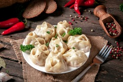 Stuffed dumplings, manti of dough and minced, close up