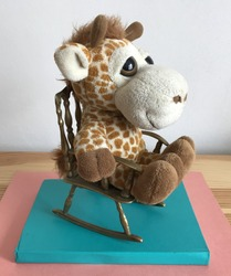Stuffed Giraffe in a Rocking Chair