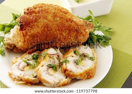 Stuffed golden fried chicken garnish with vegetables