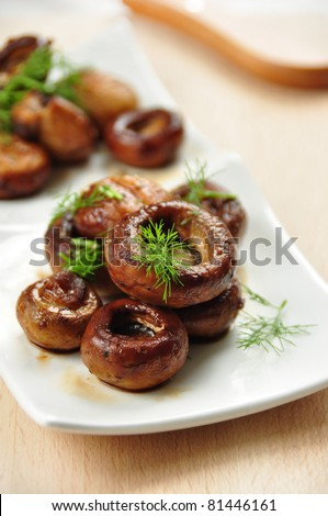 stuffed mushrooms, covered in herbs
