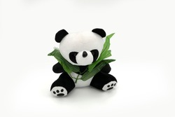 Stuffed panda toy isolated white.