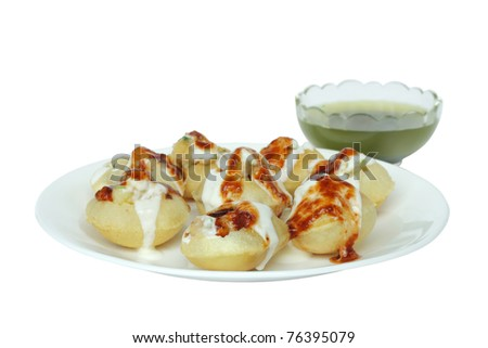Stuffed panipuri with curd and sweet tamarind topping at shallow DOF