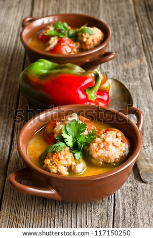 stuffed peppers in a plate on a rustic wooden background