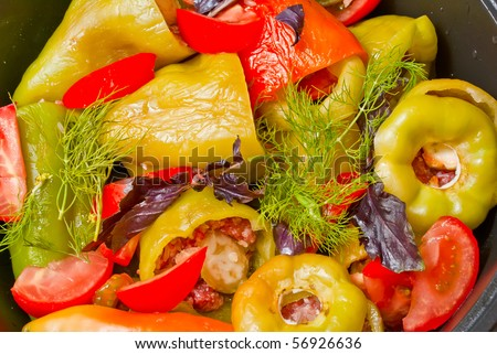 stuffed peppers in a saucepan before directing the fire - stock photo