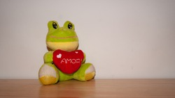 stuffed toy frog with heart that says