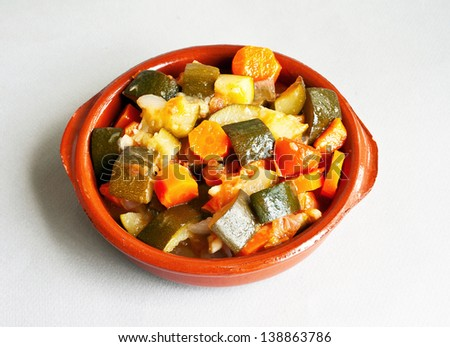 Stuffed vegetables in ceramic bowl over gray background